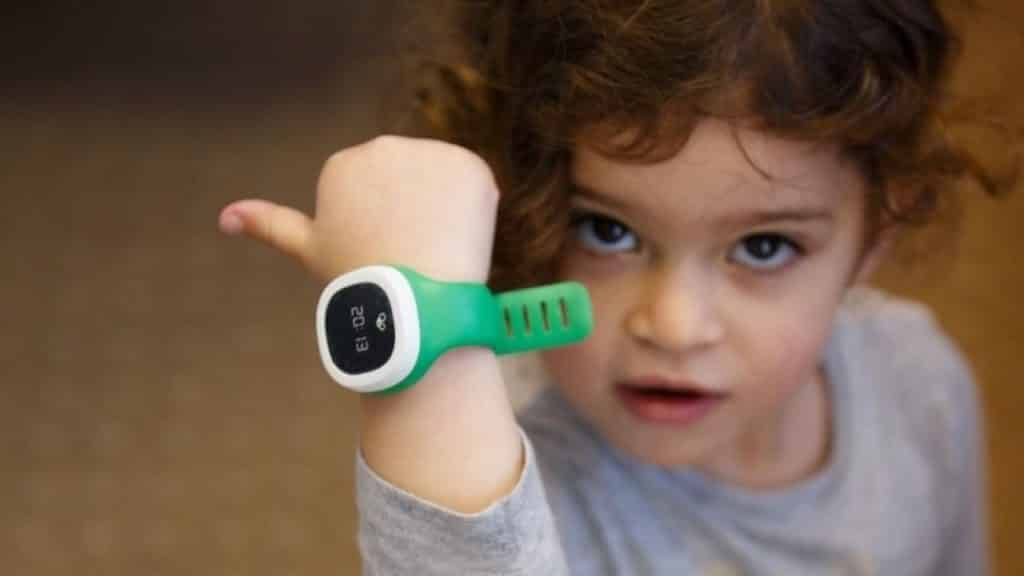 A Child Wearing a Child Tracker Modelled after a Wrist Watch