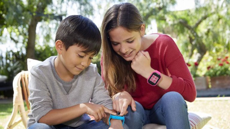 Children Sporting Child Trackers in Form of Smart Watches