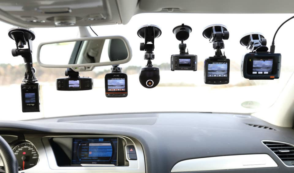 A Variety of Dashboard Cameras attached to a Vehicle's Windscreen