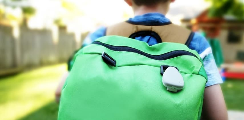 A Child Wearing a Backpack with an Attached Child Tracking Device