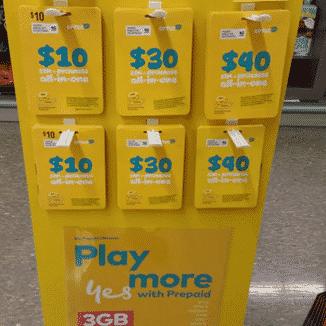 An Optus Prepaid Starter Sim Kit stand.